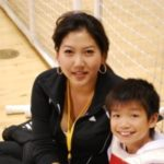 Mother and sun at martial arts event