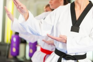 Helen Dugan  teaches self-confidence to her karate students.