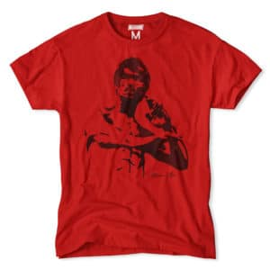 A shadow image of Bruce Lee displays on a bright red t-shirt.
