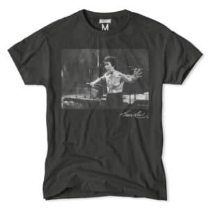 A passionate Bruce Lee demonstrates nunchucks on a grey graphic tee.