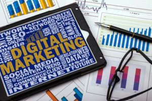 A tablet proudly displays a digital marketing strategy surrounded by graphs.
