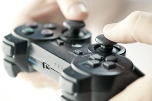 Two hands readily grasps a video game controller