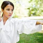 A martial artist concentrates while training outdoors.