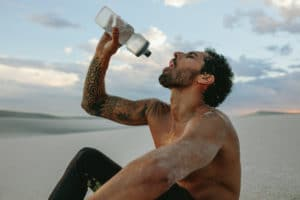 Athlete getting hydrated before a Martial Arts Competition