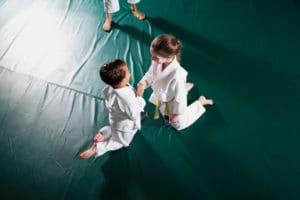 Children practicing Jiu-Jitsu, doing fist bump