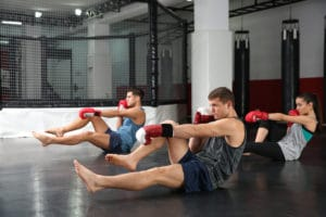 An exercise class working out with boxing gloves